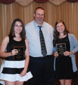 Sophomores Sara Bistany (left) and Lexie Carchedi received their Social Studies Academic AchievementAwards from Social Studies Chair Randall Grimmett.