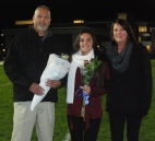 Alex Pigeon was escorted by her parents, Greg and Sharon Pigeon