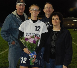 Natalie Ellard with her mom , Gina, her dad, John and her grandfather, John