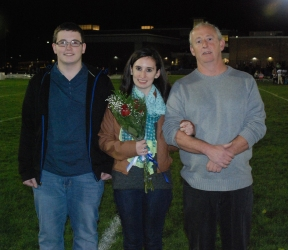 Nicole Cook was escorted by her brother John and her father Lewis.