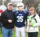 #35 owen Martin with his parents, Lisa and Matt