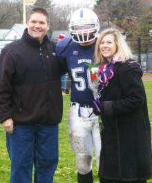 #50 Patrick Sullivan escorted by his parents, Suzanne and Kevin