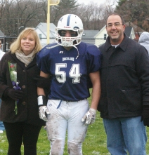#54 Dennis McPeck accompanied by his parents, Linda and Chris