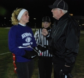 Senior quarterback, Brianna Starkey talks to refs
