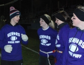 Senior coach, Cam Stuart talks to Mekenzie Levesque, Katie DeLorey, and Kaitlyn Capeau