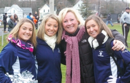 Senior cheerleaders Maddie Daly, Krystin Killion and Kelsey Girard with Coach Jeanine Reardon