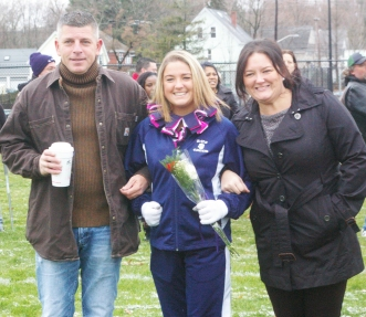 Senior Captain Madeline Daly with her parents, Kimberly and Blaise