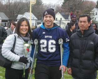 #26 Captain Justin Nguyen accompanied by his parents, Lien and Ty
