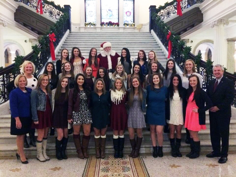 The cheerleaders visited the State House where they were recognized for winning the State Championship