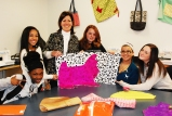 Mrs. Fleming in her sewing class. Left to right are: Vianna Andrade, Shamara Caddeus, Mrs. Fleming, Sara Yalenezian, Teddy Panagiotidis and Kaitlyn Roche.