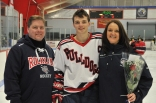 Colin Sheehan with his parents on Senior Night for the hockey team