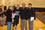 Senior Dennis McPeck with his mother and father and Coach Tim Brown.