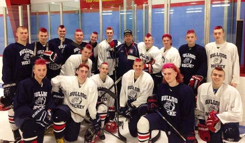 Hockey players before the Abington game posed with their new dye and cut styles.  Last night's game with Abington was designated a pink-out game for breast cancer awareness and support.