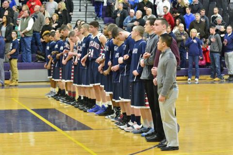 The Dogs line up for the National Anthem before last Thursday's game with Norton. photos by Rockland High Sports