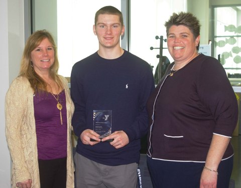 Guidance Counselor Denise Davidson, RHS Asst. Principal Kathy Paulding congratulate senior Mike Leavitt for his award.