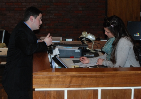 Senior Pearse McNally confers with Mock Trial Advisor, Ms. Lanigan.
