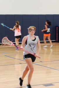 Kathleen Mansfield goes through a drill for lacrosse. Photo by Ryan Palmer