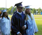 Right to left: Brianna Starkey, Mike Leavitt and Michelle Cavalieri file into the stadium.