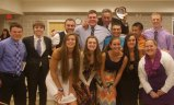 Seniors gather after the ceremony with Mr. Graziano and Ms. Walsh.