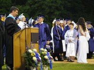 Senior Matt Bille walks up to the podium to receive his diploma.