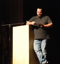 English teacher, Chris Neal reads the rules and organizes the Sophomore Story Slam on Friday, May 8. Photo by Jurnee Dunn