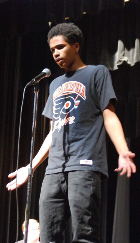 Myles Fonfield tells a story about the lessons from his father at the Story Slam. Myles' story was awarded first place.  Photo by Jurnee Dunn
