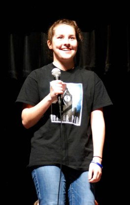 Sophomore Sophie McLellan tells her story at the Slam on Friday, May 8. photo by Jurnee Dunn