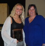Brianna Starkey received the top female athlete award from softball coach Sharon McGonnigal.