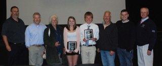 The first annual Charles E. Leverone Award was given in memory of long-time track and cross country coach who passed away this year. Kara Penney and Ian Welch were the recipients. They were joined by coaches Randall Grimmett and Robert Murphy and Leverone's family including his sons, grandson and wife, Toni.