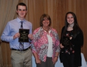 Sophomores Chris McHugh and Erin Buckley receive awards in Physical Education from Mrs. Folsom.