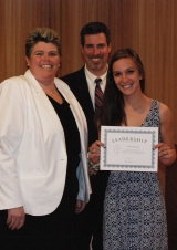 Colleen McCarthy receives a Leadership Award from Ms. Paulding and Dr. Cron.