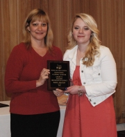 Haley Macray, multiple award winner for English and History/Social Science, receives award from Mrs. Shaw.