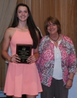 Erika Oschenduszko is presented with the Grade 9 Academic Achiever Award for Physical Education by Brenda Folsom.