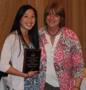 Brenda Folsom, director of technical education, presents Isabelle Uong with the Grade 9 Academic Achiever Award in Technical Education.