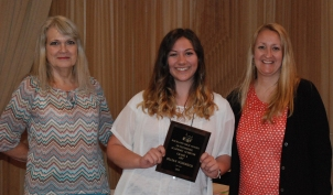 Art teachers, Sandy Gibson and Cheryl Thompson present Jillian Schofield with the grade 9 Academic Achiever Award.