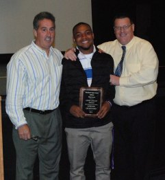 Leshon Crawford received the Louis Cifello Award from Gary Graziano and Fred Damon.
