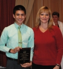 Michael Belmonte receives Academic Achiever Award in Mathematics for Grade 10 from Mrs. Shaw.