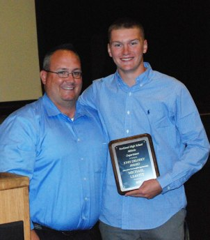 Mike Leavitt was presented the John Delorey Award by baseball coach Nick Liquori.