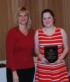 Saoirse McNally receives award for History/Social Science from guidance counselor, Melanie Shaw.