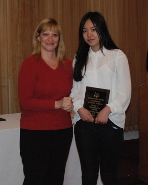 Fanting Zhou is the grade 11 academic achiever in math and science presented by Guidance Director, Melanie Shaw.