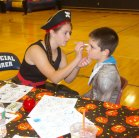 Kylie McKenna painting a face for Halloween