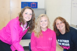 Sophomore Hannah Boben, Freshman Meghan Dion, and math teacher Mrs. Mulready showing their support.