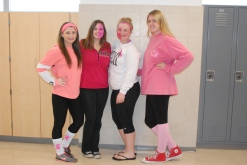 Senior Liz Knobel, Junior Brittany Pitts, and Seniors Caitlin Yannizzi and Kaleigh Pishkin strike a pose for pink out day.