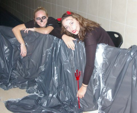 Julia DiCienzio and Hannah Boben in the haunted hallway of project pumpkin. Veritas file photo