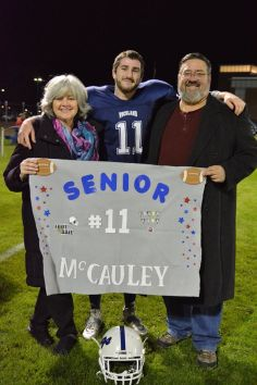 Russell McCauley and his parents, Christina and Wally