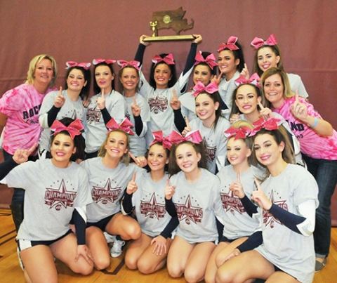Cheerleaders with their State Championship trophy photo by Kelley Reale
