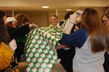 The Finance and Fundraising Committee works on wrapping their gift.