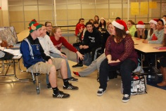 Members of the Community Service Committee work discuss answers during Holiday Jeopardy.