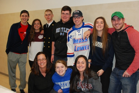 Members of the Class of 2015 and Ms. Lombardi (front left) pose for a picture at the annual RHS College Fair.