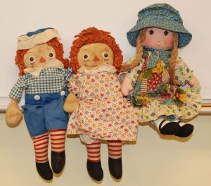 Ms. Cahill's Raggedy Ann and Andy dolls along with her Holly Hobby doll